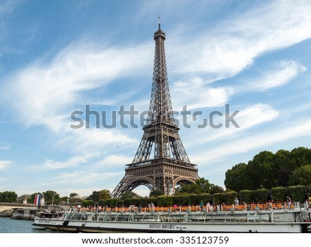 PARIS, FRANCE - SEPTEMBER 9, 2014: A view of a Seine river with Eiffel Tower in Paris. The most famous symbol of Paris, France - stock photo
