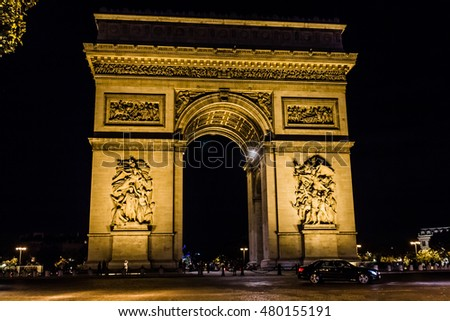 PARIS, FRANCE, SEPTEMBER: Arc de Triomphe (Arch of Triumph) against the background of night dark sky.