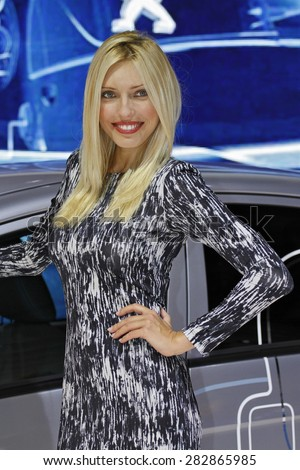 Paris, France - September 30: Beautiful hostess by the car on Paris Motor Show on September 30, 2010 in Paris.