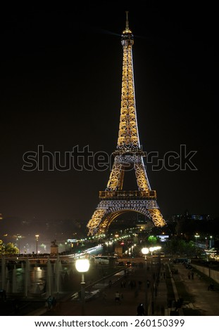 PARIS, FRANCE - SEPTEMBER 11, 2014 : Eiffel Tower brightly illuminated at night in September in Paris. The Eiffel tower is the most visited monument of France.