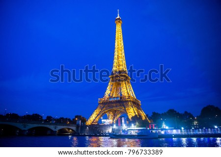 PARIS, France - september 23, 2017: Eiffel Tower Lighting in Paris. Eluminate Eiffel tower is the most popular travel place and global cultural icon of the France and the world.
