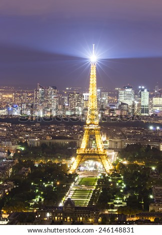 PARIS, FRANCE - SEPTEMBER 21, 2011: Eiffel Tower seen from Montparnasse tower on September 21, 2011 in Paris. It is the most visited monument of France with about 6 million visitors every year  - stock photo