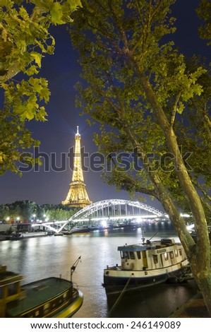 PARIS, FRANCE - SEPTEMBER 22, 2011: Eiffel Tower seen from Seine river on September 21, 2011 in Paris. The Eiffel tower is the most visited monument of France with about 6 million visitors every year  - stock photo