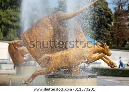 PARIS, FRANCE - SEPTEMBER 9, 2014: Fountains at Tracadero. Trocadero is area of Paris on banks of Seine not far from famous Eiffel Tower. Paris, France. - stock photo