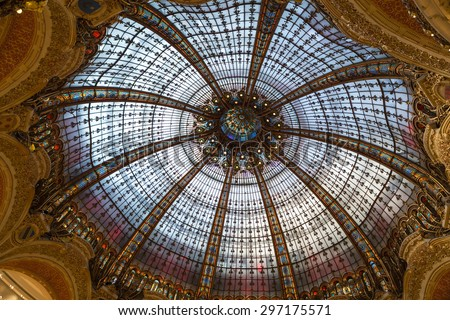 PARIS, FRANCE - SEPTEMBER 10, 2014: Galeries Lafayette interior in Paris. The architect Georges Chedanne designed the store where a Art Nouveau glass and steel dome  - stock photo