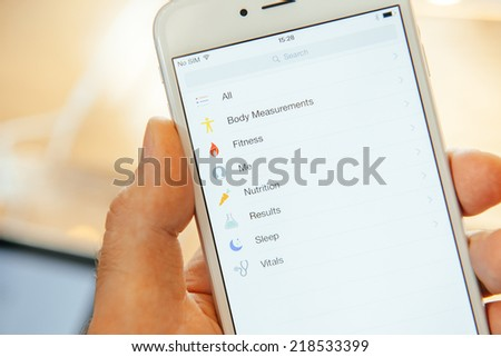 PARIS, FRANCE - SEPTEMBER 20, 2014: Hand holding a iPhone 6 Plus displaying the new Health App during the sales launch of the latest Apple Inc. smartphones at the Apple store in Paris, France - stock photo