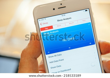 PARIS, FRANCE - SEPTEMBER 20, 2014: Hand holding a iPhone 6 Plus displaying the new Health App and Sleep Analysis module during the sales launch of the latest Apple Inc. smartphones at the Apple store - stock photo