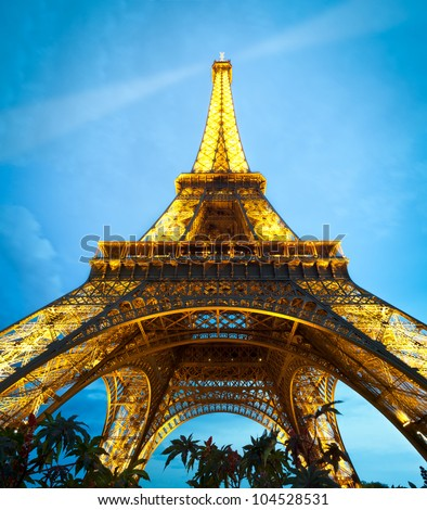 PARIS, FRANCE - SEPTEMBER 3: Illuminated Eiffel Tower at night. The most popular tourist attraction in France. September 3, 2011, Paris, France, Europe. - stock photo