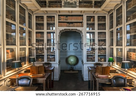 PARIS, FRANCE - SEPTEMBER 14, 2014: Interior of library at Ecole Militaire (Military School was founded by Louis XV in 1750). Complex of military training facilities located on Champ de Mars in Paris. - stock photo