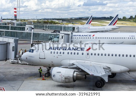 PARIS, FRANCE - SEPTEMBER 1, 2015. International airport Charles de Gaulle. Land service of the plane at the airport - stock photo