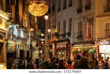 PARIS, FRANCE - SEPTEMBER 11, 2014: Latin Quarter of Paris, France. Narrow street of Paris among old traditional parisian houses and cafe in Paris.