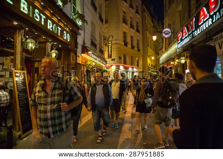 PARIS, FRANCE - SEPTEMBER 9, 2014: Latin Quarter of Paris, France. Narrow street of Paris among old traditional parisian houses and cafe in Paris.