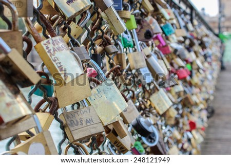 PARIS, FRANCE - SEPTEMBER 02: Love locks placed by tourists on the Pont des Arts on the river Seine, on September 02, 2012 in Paris, France. - stock photo
