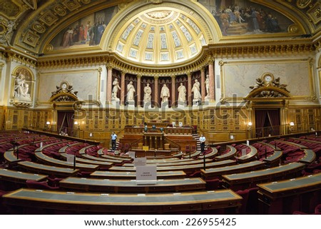 PARIS, FRANCE - SEPTEMBER 14, 2013: Meeting hall of Senate in the Luxembourg Palace. The palace was originally built in XVII century, and since 1958 it houses the French Senate of the Fifth Republic - stock photo