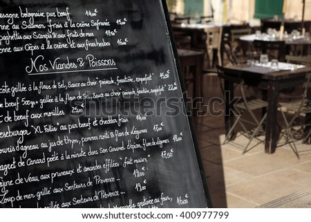 Paris, France : September 16, 2010 - Menu board outside a french restaurant in the marais district of paris france