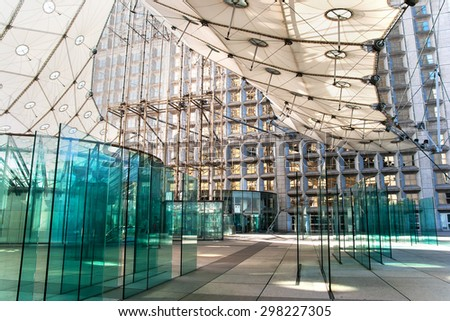 PARIS, FRANCE - 15 SEPTEMBER 2011: Modern architecture of the La Grande Arche de la Defense. La Defense is a major business district of the Paris Metropolitan Area built in 1883