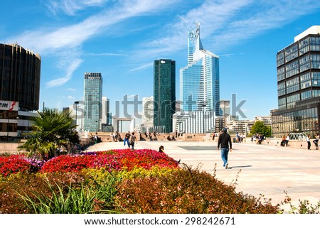 PARIS, FRANCE - 15 SEPTEMBER 2011: Office Buildings in La Defense; view from the Avenue de la Grande Arche. La Defense is a major business district of the Paris Metropolitan Area built in 1883.