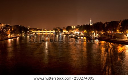 PARIS, FRANCE - SEPTEMBER 7, 2014: Old town of Paris, France on 7 September 2014. Paris is one the world's leading tourist destinations. In 2013 Paris welcomed 15.6 million international visitors. - stock photo