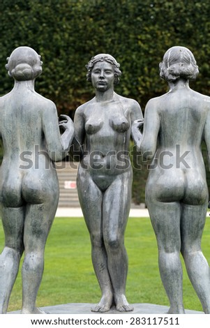 PARIS, FRANCE - SEPTEMBER 11, 2014: Paris -  Bronze sculpture The Three Nymphs  by Aristide Maillol in Tuileries garden - stock photo