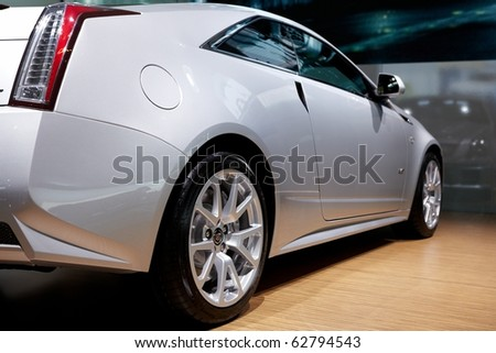 PARIS, FRANCE - SEPTEMBER 30: Paris Motor Show on September 30, 2010 in Paris, showing Cadillac CTS Coupe, rear-side closeup view - stock photo