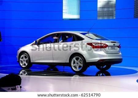 PARIS, FRANCE - SEPTEMBER 30: Paris Motor Show on September 30, 2010 in Paris, showing Ford Focus Sedan, rear view - stock photo