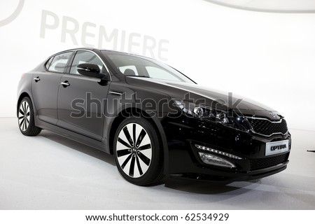 PARIS, FRANCE - SEPTEMBER 30: Paris Motor Show on September 30, 2010 in Paris, showing Kia Optima, front view - stock photo