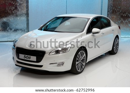 PARIS, FRANCE - SEPTEMBER 30: Paris Motor Show on September 30, 2010 in Paris, showing Peugeot 508 GT, front view - stock photo