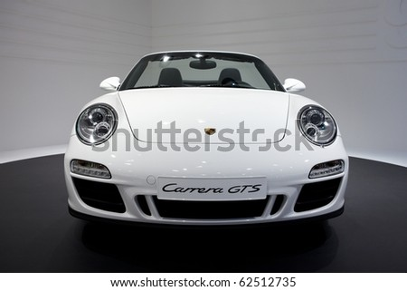 PARIS, FRANCE - SEPTEMBER 30: Paris Motor Show on September 30, 2010 in Paris, showing Porsche 911 Carrera GTS Cabriololet, front view - stock photo