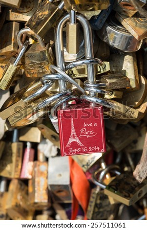 PARIS, FRANCE - SEPTEMBER 8, 2014: Paris - Pont de l'Archeveche (Archbishop's Bridge)covered with love padlocks. The Pont de l'Archeveche is the narrowest road bridge in Paris - stock photo
