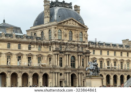 PARIS, FRANCE - SEPTEMBER 11, 2014: Paris - The Louvre Museum. Louvre is one of the biggest Museum in the world, receiving more than 8 million visitors each year. Paris, France - stock photo