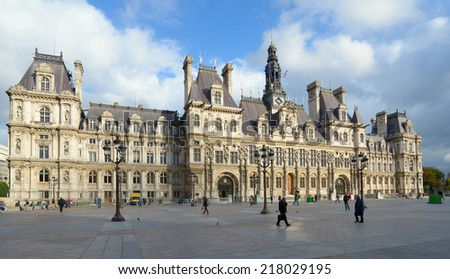 PARIS, FRANCE - SEPTEMBER 11, 2013: People on the Place de l'Hotel-de-Ville against the City Hall building. The City of Paris's administration has been located on the same location since 1357