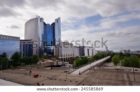 PARIS, FRANCE - SEPTEMBER 21, 2011: Photo of the north side of the main square in La Defense district, large modern business centre in the western part of Paris, France.  - stock photo