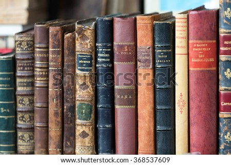 PARIS, FRANCE - SEPTEMBER 9, 2014: Second-hand book market on quai of river Seine near cathedral Notre Dame de Paris The bookmarket on the banks of the Seine is there since the 16th century - stock photo