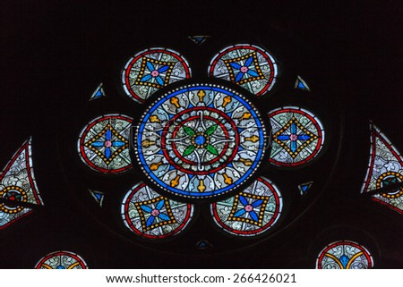 PARIS, FRANCE - SEPTEMBER 8, 2014: Stained glass windows inside the Notre Dame Cathedral, UNESCO World Heritage Site. Paris, France