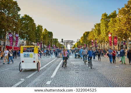 PARIS, FRANCE - SEPTEMBER 27: The Champs-Elysees and the Arc de Triomphe, on September 27, 2015 in Paris, France, during Day without cars (Journee sans voitures) event