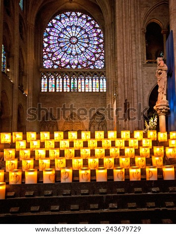 PARIS, FRANCE - 8 SEPTEMBER, 2014: The famous Notre Dame de Paris on september 8, 2014 in Paris. The cathedral of Notre Dame is one of the top tourist destinations in Paris. - stock photo