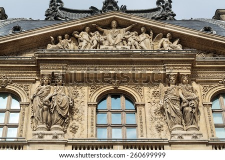 PARIS, FRANCE - SEPTEMBER 11, 2014: The Louvre Museum. Louvre is one of the biggest Museum in the world, receiving more than 8 million visitors each year. Paris, France  - stock photo