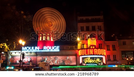 PARIS, FRANCE - 6 SEPTEMBER, 2014: The Moulin Rouge by night, on September 6, 2014 in Paris, France. Moulin Rouge is a famous cabaret built in 1889, located in the Paris red-light district of Pigalle  - stock photo
