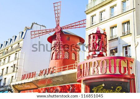 PARIS, FRANCE - SEPTEMBER 9: The Moulin Rouge during the day, on September 09, 2012 in Paris, France. Moulin Rouge is the most famous Parisian cabaret and it created the modern can-can dance. - stock photo