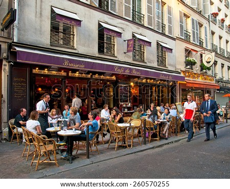 PARIS, FRANCE - 8 SEPTEMBER, 2014: Typical bar in the old town of Paris, France on 8 September 2014. . Paris is one of the most populated metropolitan areas in Europe full of bars and cafes. - stock photo