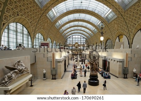 PARIS, FRANCE - SEPTEMBER 12, 2013: Visitors in the Musee d'Orsay. Opened in 1986, the museum houses the largest collection of impressionist and post-impressionist masterpieces in the world - stock photo