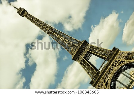 Paris, France - Side view of the Eiffel tower one of the most recognizable landmarks in the world. - stock photo
