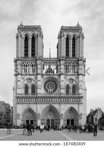 PARIS, FRANCE - 19TH MARCH 2014: The outside of Notre Dame during the day showing people at the base of it