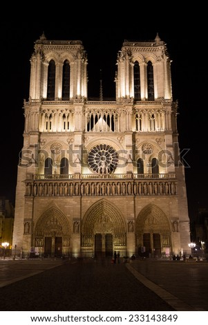 PARIS, FRANCE: The outside of Notre Dame at Night. People can be seen