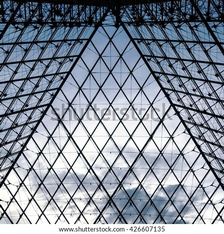 PARIS, FRANCE - 08.16.2004. - The Pyramid abstract metal and glass structure view inside the Louvre museum - stock photo