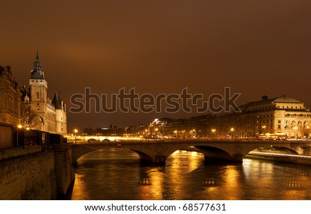 Paris from the Seine river at night