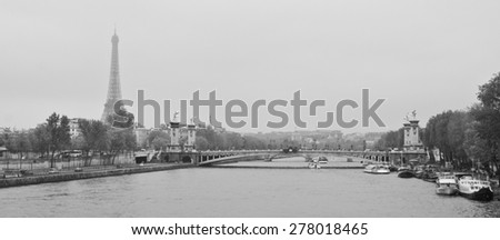 Paris from the Seine river in black and white. Sena in Paris - stock photo