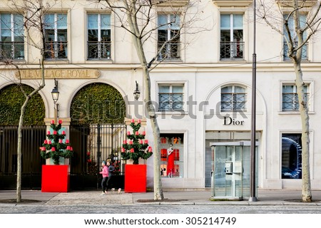 PARIS-JAN 5, 2014: Dior boutique exterior decorated for Christmas on a Paris street.The French luxury goods company was founded in 1946 by fashion designer Christian Dior and is a world famous brand. - stock photo