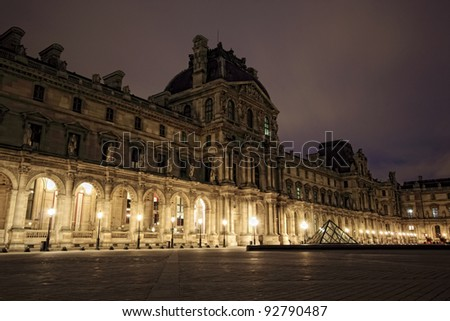 PARIS - JAN 8 : Louvre museum at dusk in Paris, France. Louvre is the biggest Museum in Paris displayed over 60,000 square meters of exhibition space. on January 8th 2012 in Paris, France - stock photo