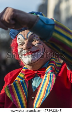 PARIS - January 1: Clown makes presenting his show on a sidewalk near Pompidou Centre on January 1, 2015 in Paris, France.  - stock photo